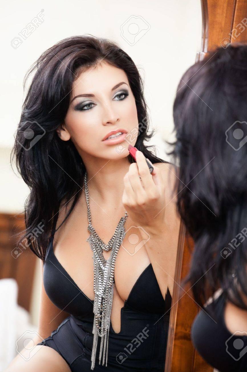 Sexy sensual woman applying lipstick in the mirror Stock Photo - 12552658