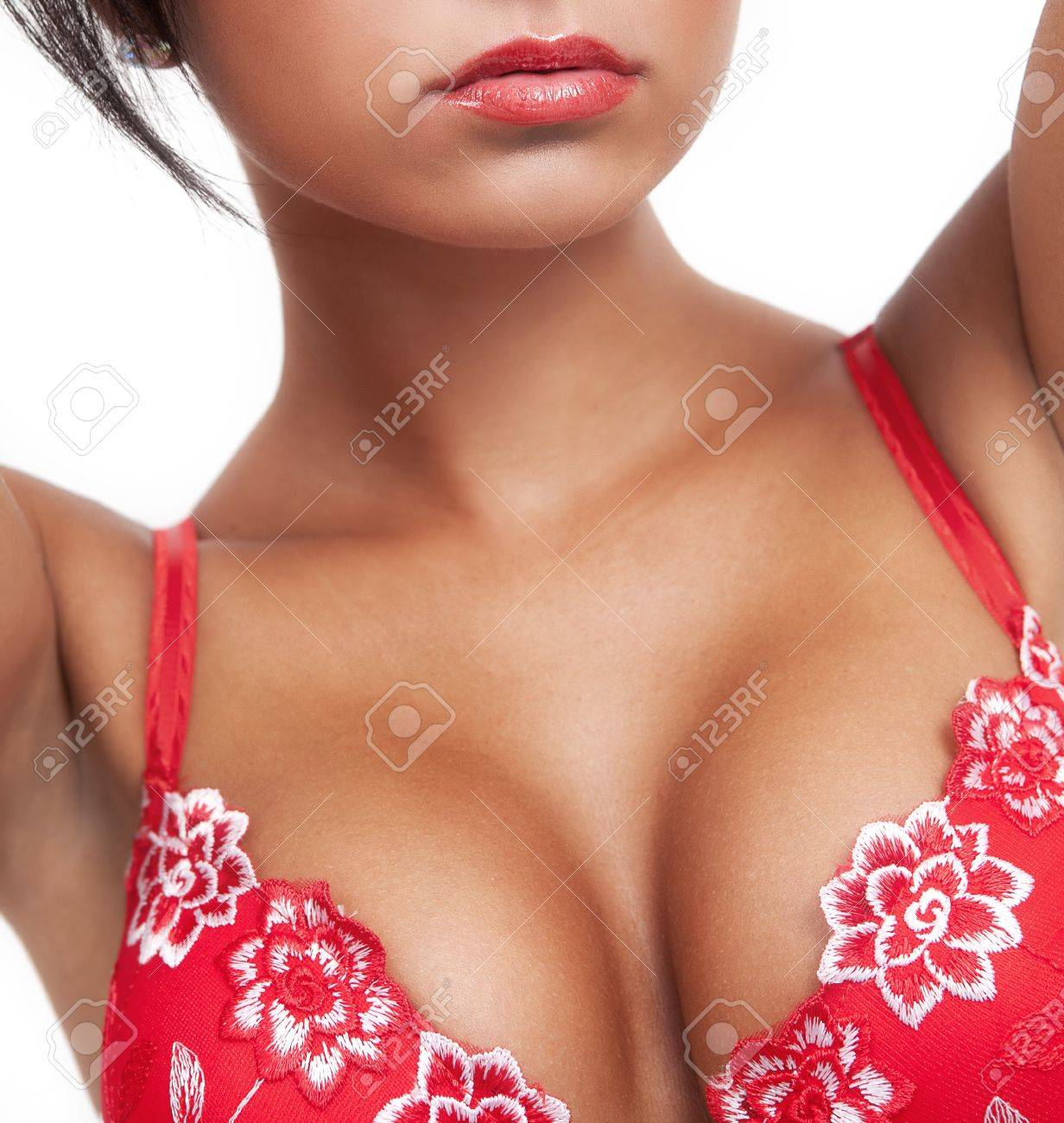 Woman with hot sexy breasts in red lingerie Stock Photo - 12619588