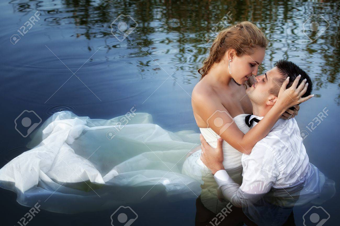 Love and passion - kiss of married young couple in water Stock Photo - 12865866