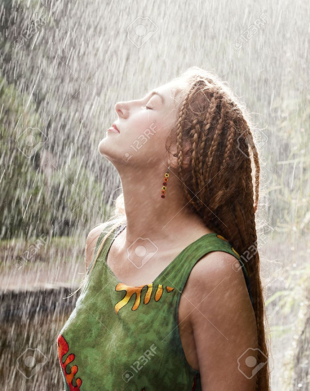 Woman refreshing outdoor in the rain Stock Photo - 13442479