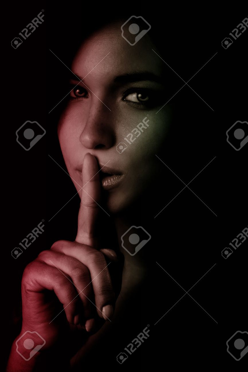 Shhh secret concept - woman with finger over lips Stock Photo - 45393301