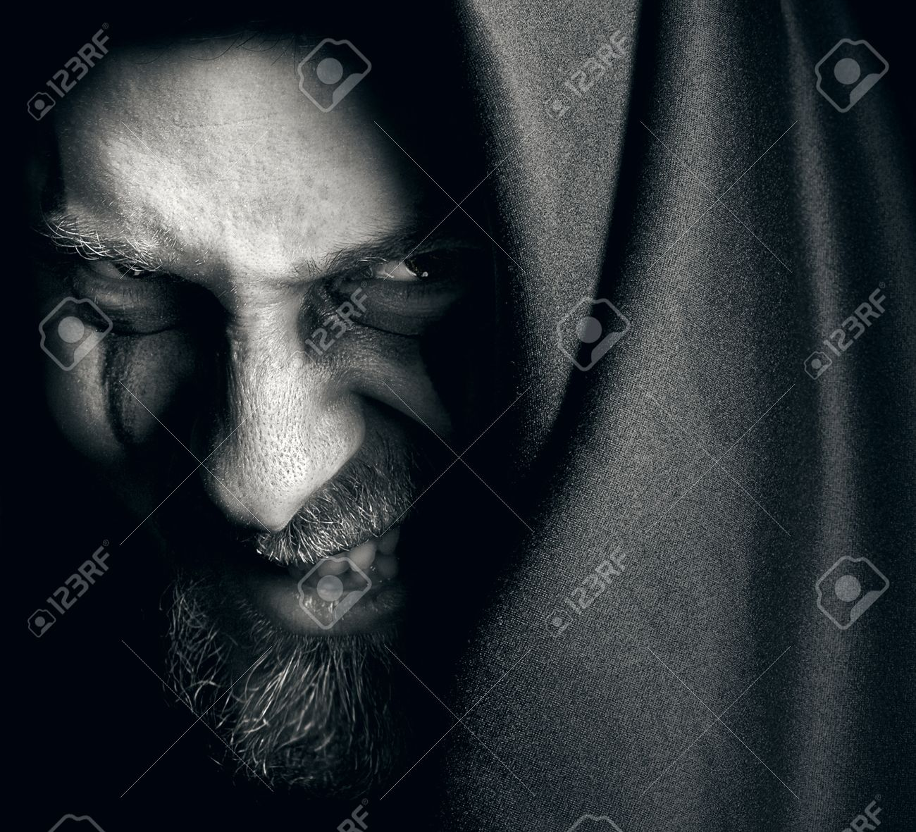 Evil sinister man with malefic grin Stock Photo - 55827437