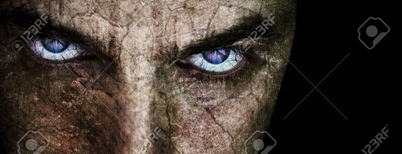 Cracked face with sinister evil scary eyes over black Stock Photo - 55802290