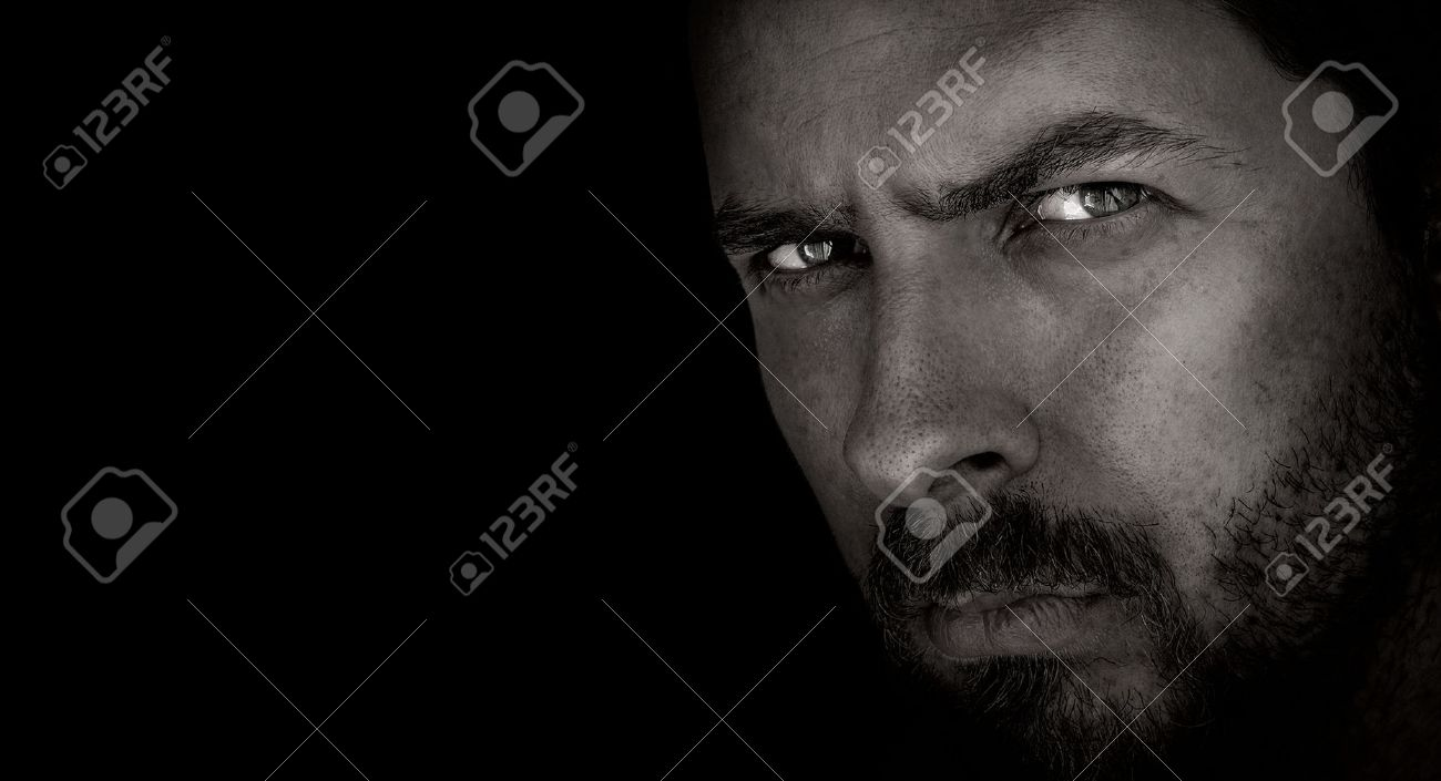 Low-key portrait of scary man with evil eyes Stock Photo - 55802632