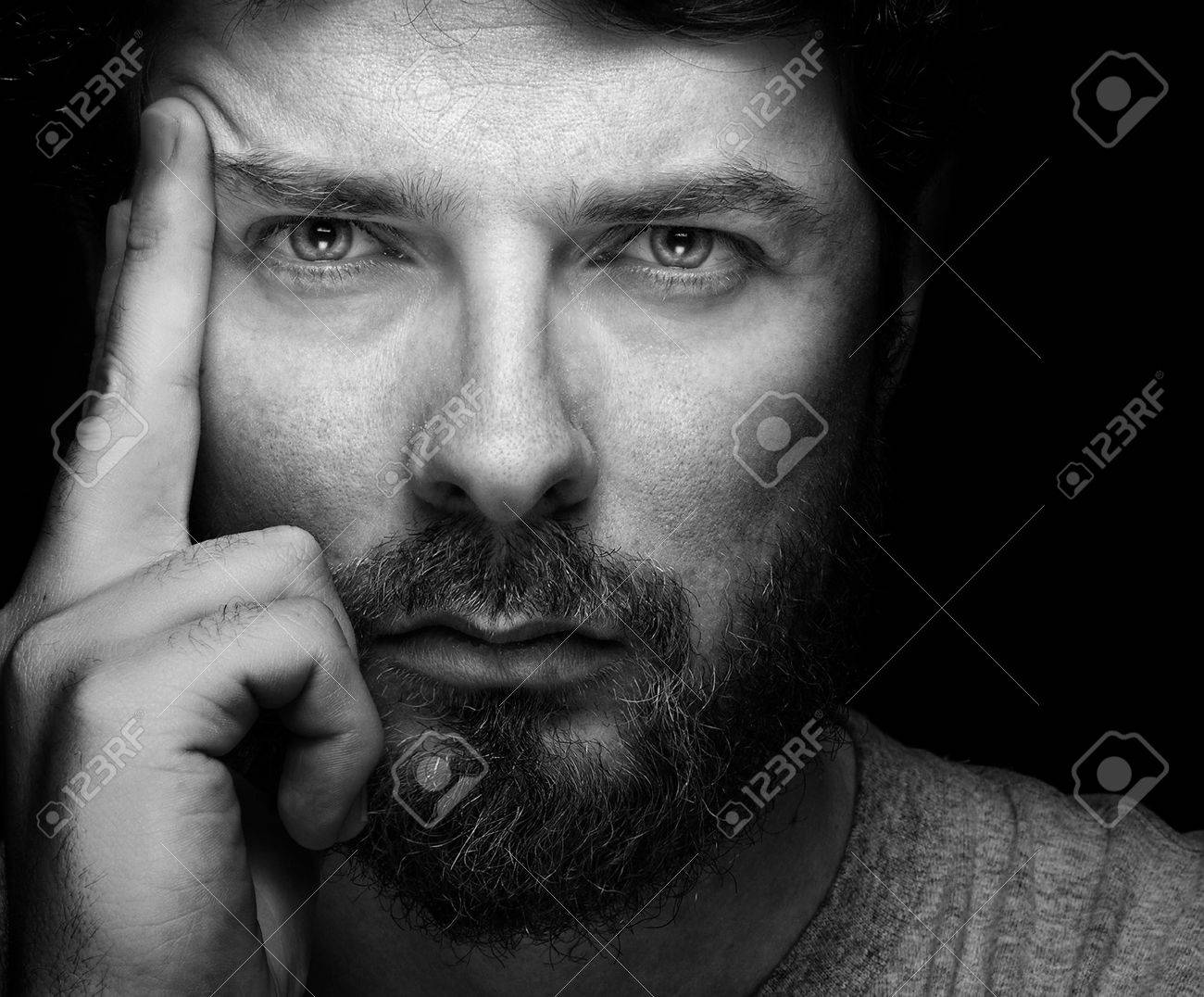 Face of handsome bearded confident young guy Stock Photo - 55802657