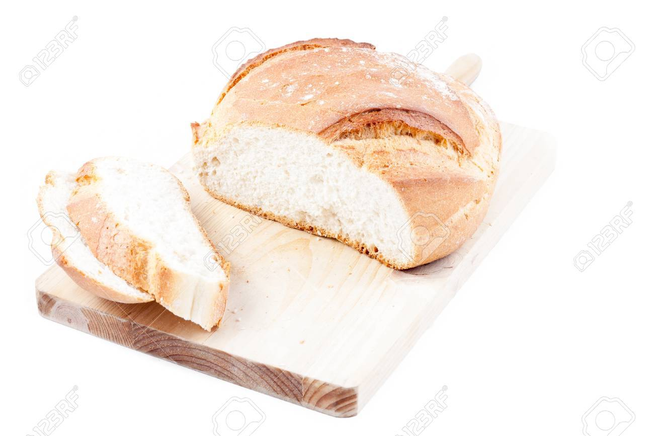 Hogaza  Spanish bread, similar to bread boule  over a kitchen cutting board isolated in a white background Stock Photo - 14505370