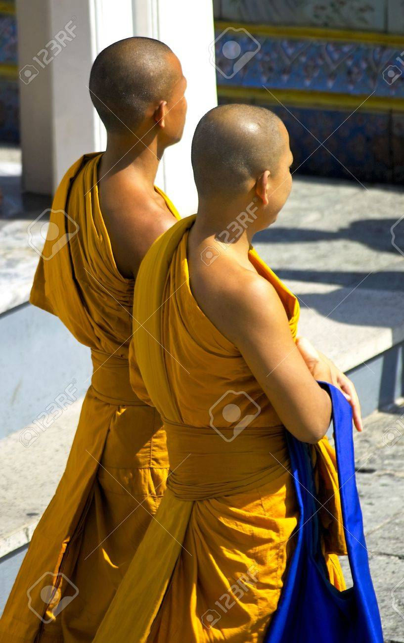 Two monks strolling in the grounds of the Grand Palace in Bangkok Stock Photo - 5792880
