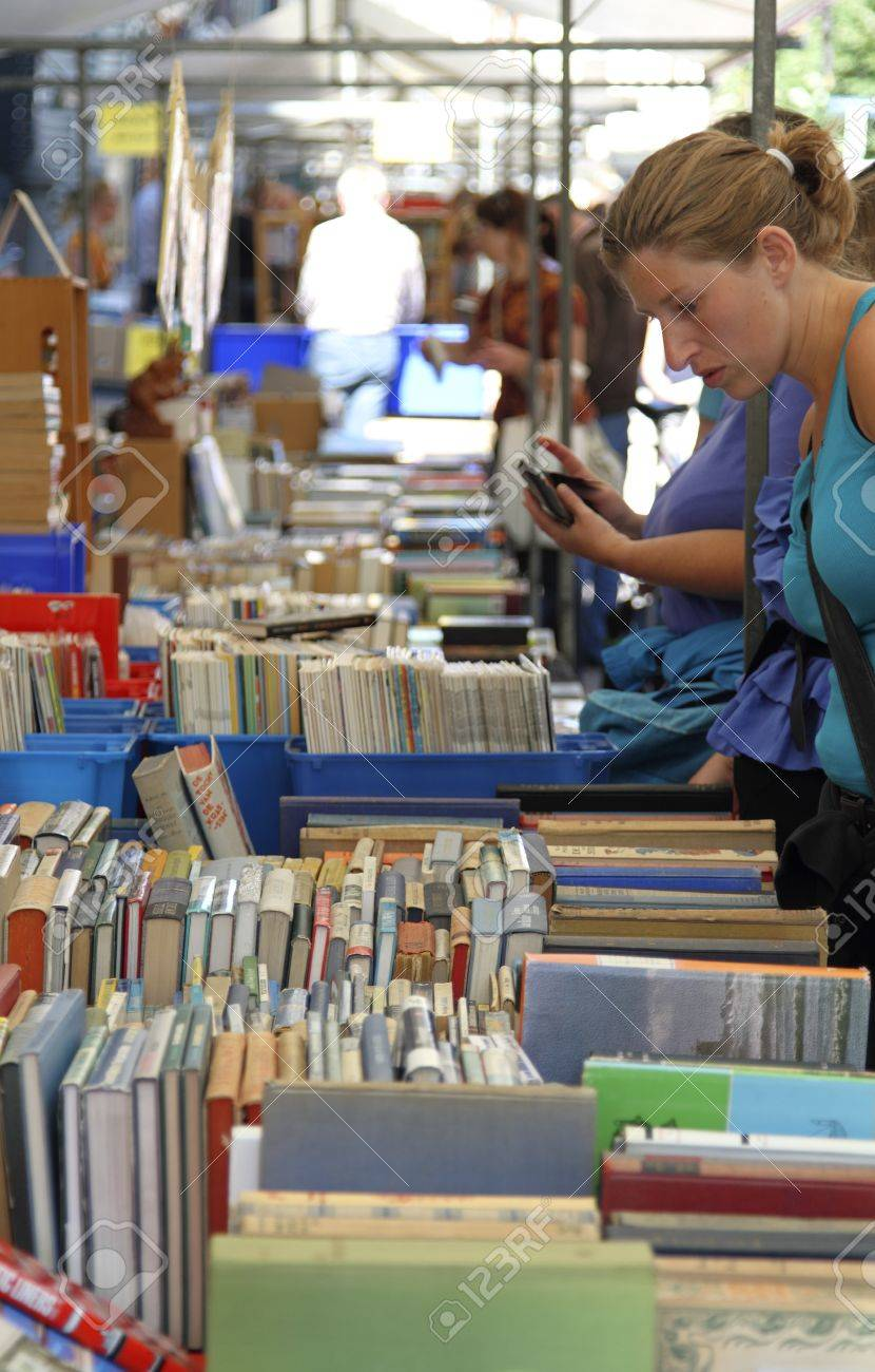 DORDRECHT, THE NETHERLANDS - JULY 3: Woman looking at books displayed on a stall Sunday July 3, 2011 in Dordrecht. This famous book market and fair is held every year in the city of Dordrecht Stock Photo - 9891308