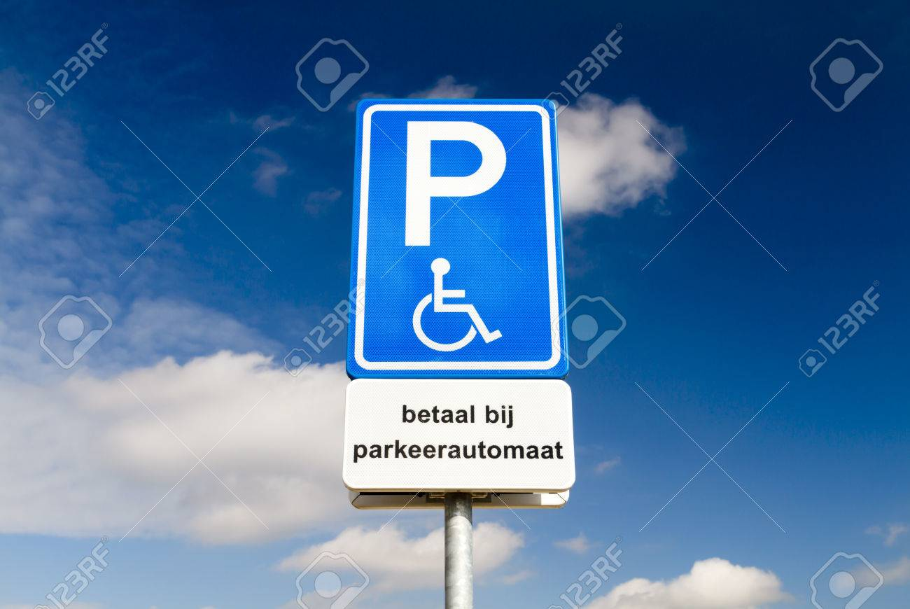 Blue Handicapped Parking Sign For Disabled Drivers Against A ...