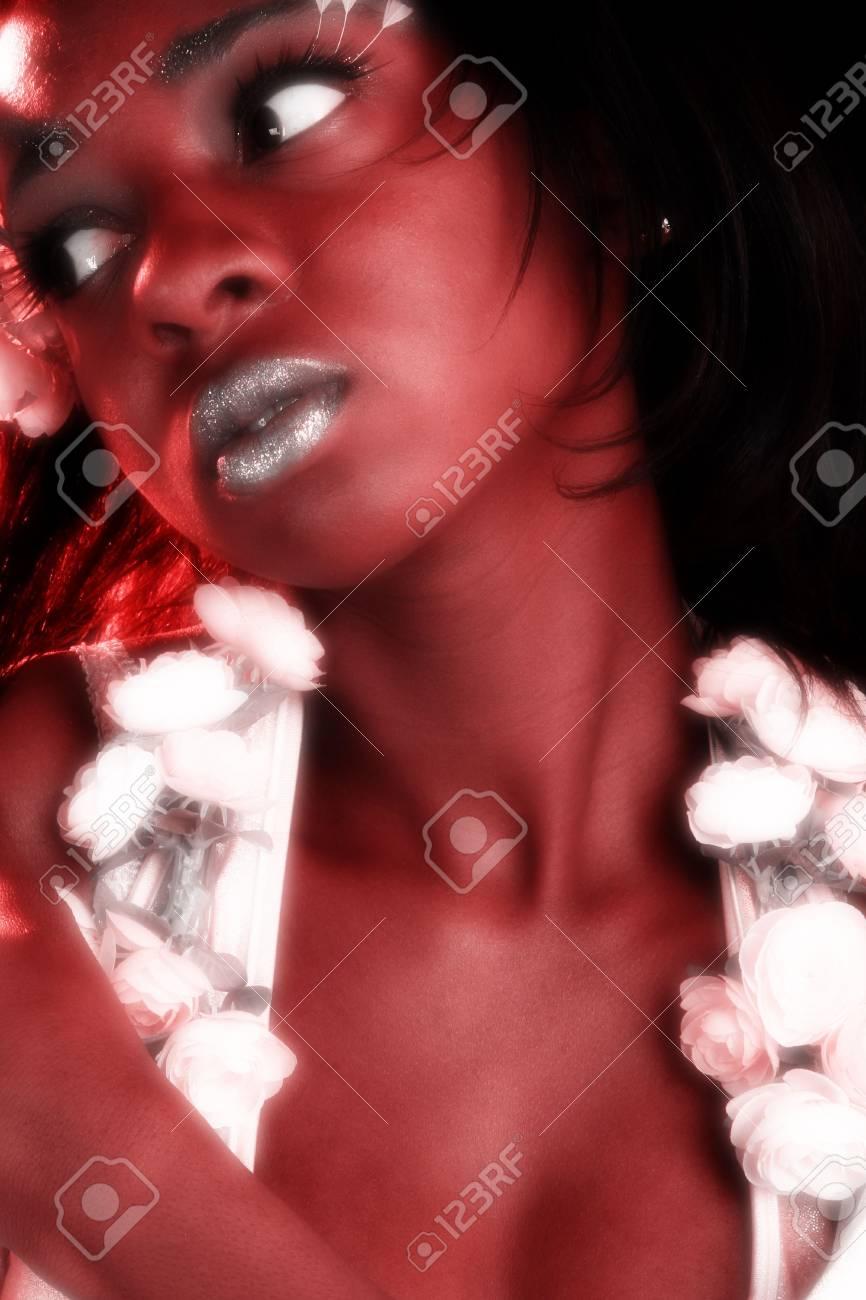 Beautiful twenty something african american woman in artistic cosmetics. Stock Photo - 2016933
