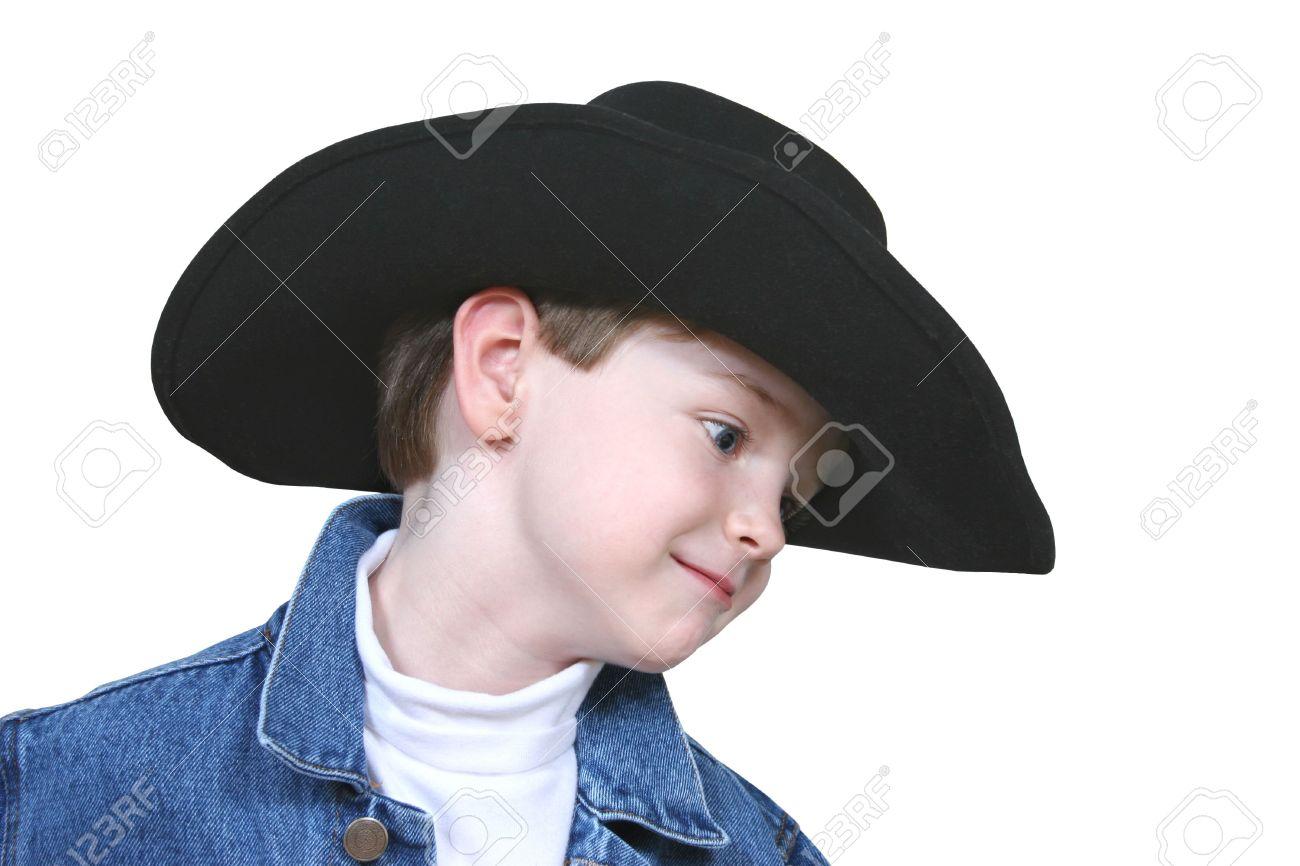 Four year old boy wearing a blue denim jacket and a black cowboy hat. Shot 900168b3690