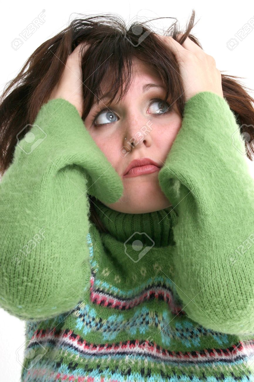 Close Up of Beautiful Teen Girl In Green Sweater. Dark hair and blue eyes. Hands in hair and troubled expression. Shot in studio over white. Stock Photo - 3741263