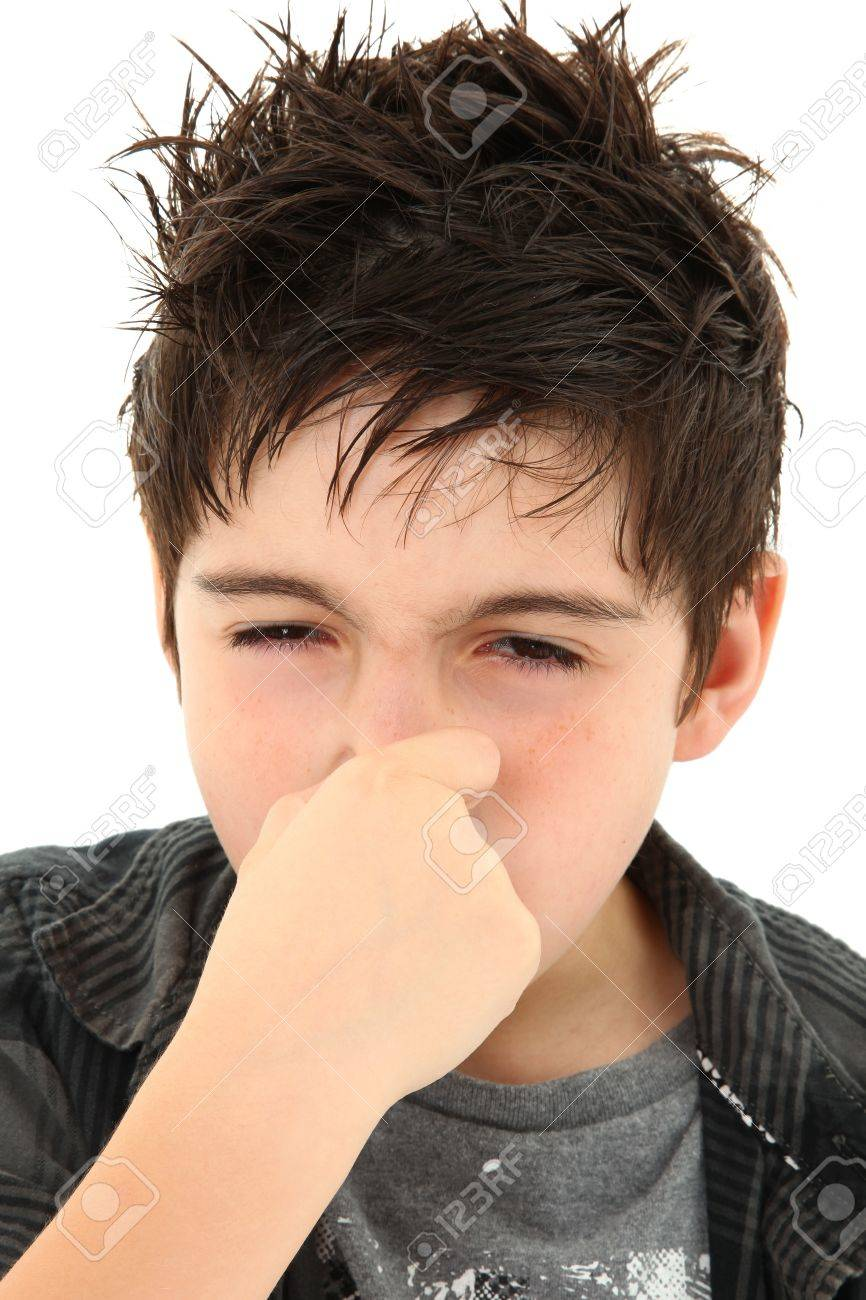 Adorable young boy making allergy stinky face expression over white. Stock Photo - 9739093