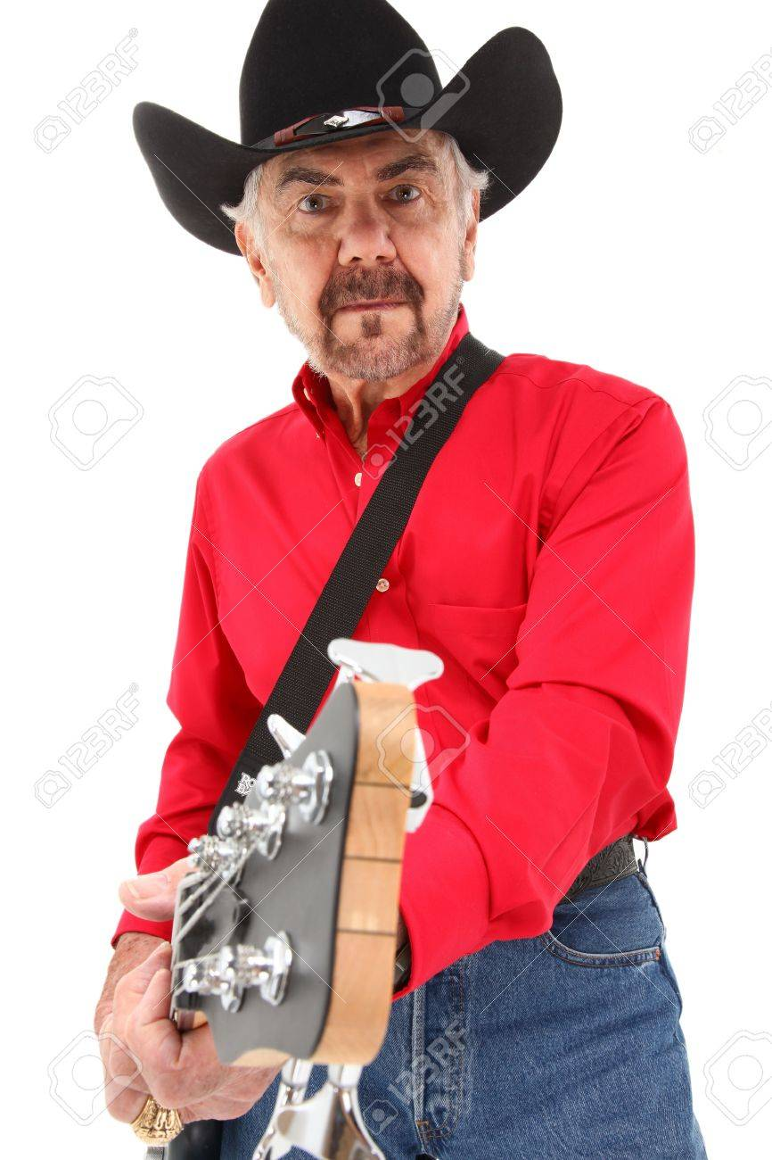 492b71ba427cc Handsome eldery 75 year old country musician with electric bass guitar and cowboy  hat over white