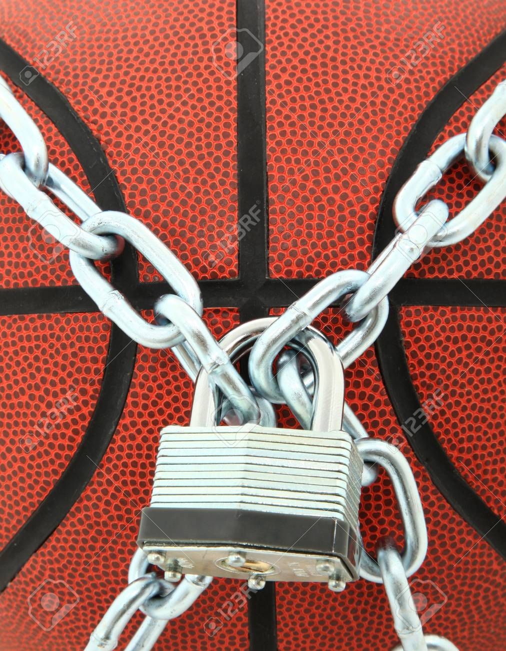 Closeup Of Basketball With Chain Link and Padlock Stock Photo - 11154431