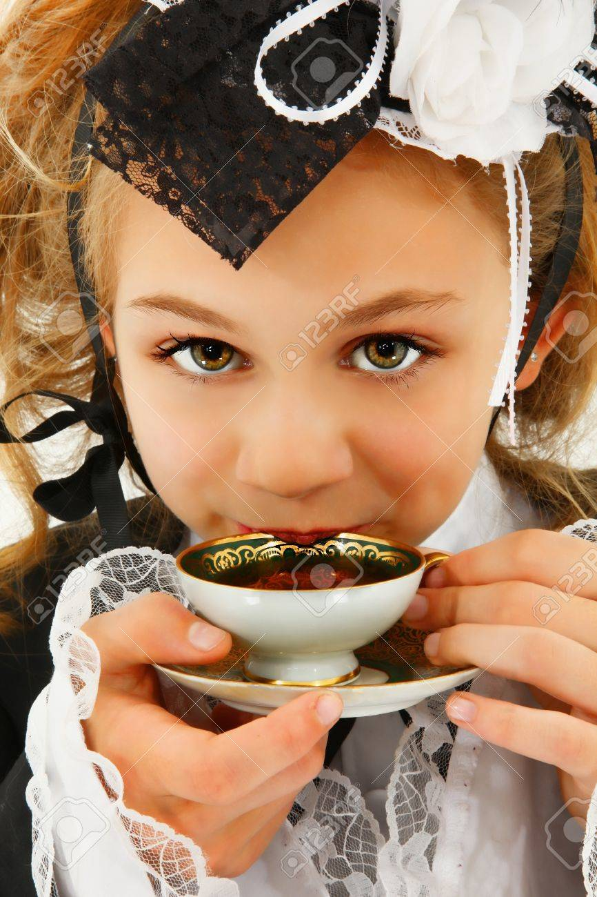 Beautiful Tween Girl In Cosplay Fashion Sipping Tea Stock Photo Picture And Royalty Free Image 20791554