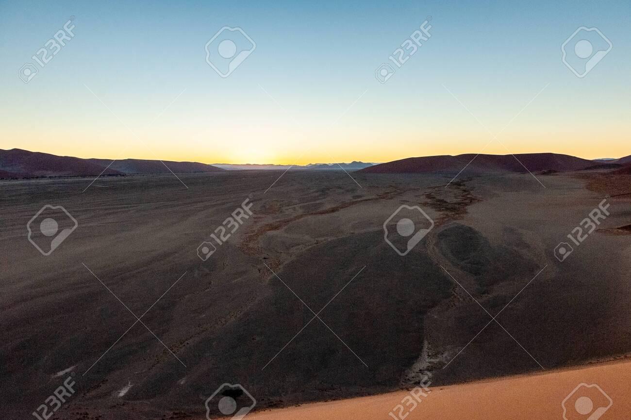 The Rising Sun Illuminating The Mighty Dunes Of The Sossusvlei
