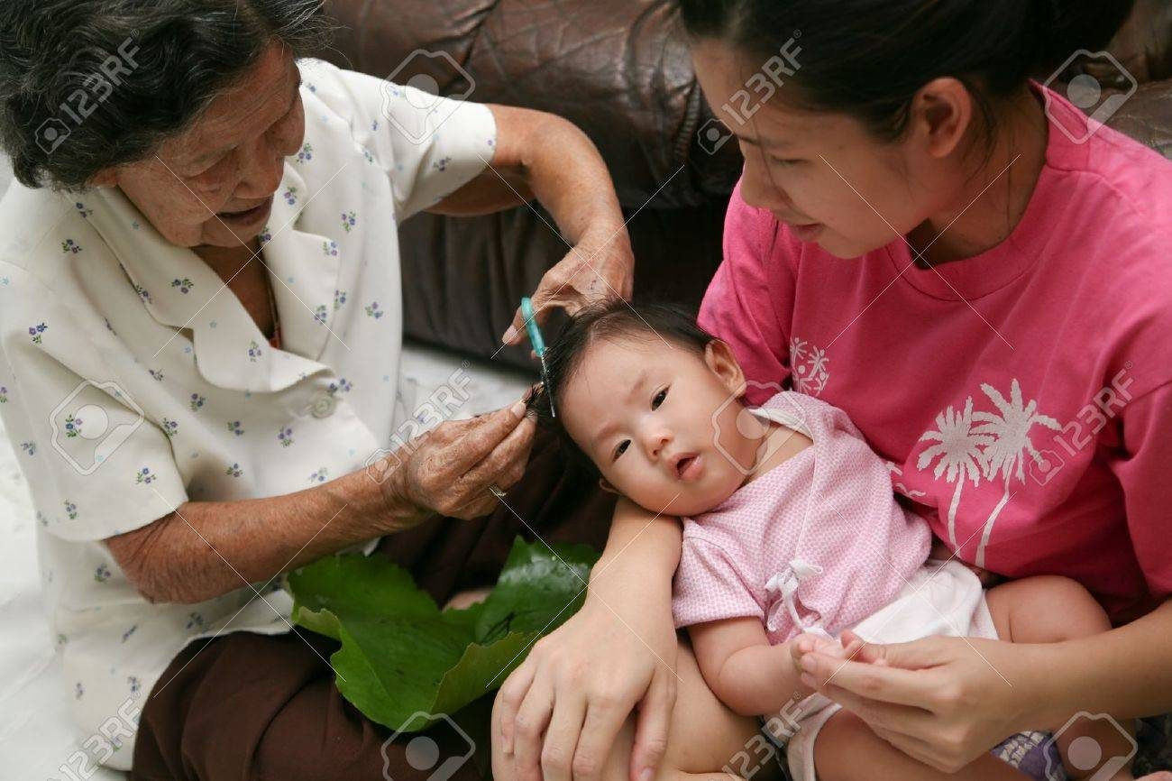 6 Month Old Asian Baby Girl Having A Haircut Stock Photo Picture