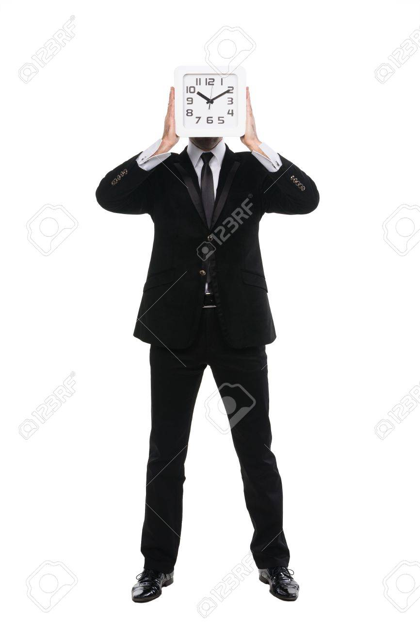 Stylish man holding up wall clock in front of his face. Isolated over white. Stock Photo - 17195476