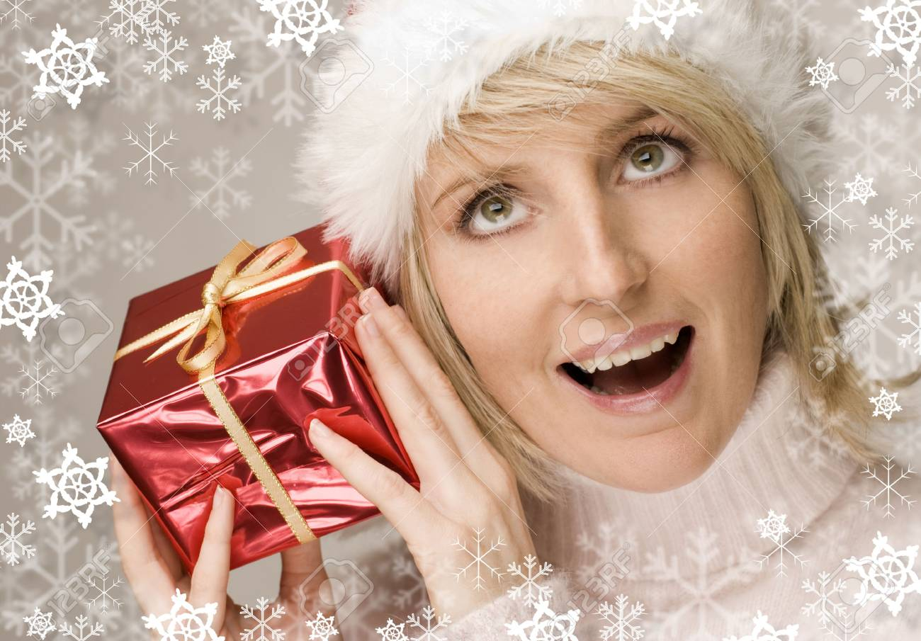 young santa girl with red present close up shoot Stock Photo - 2242457