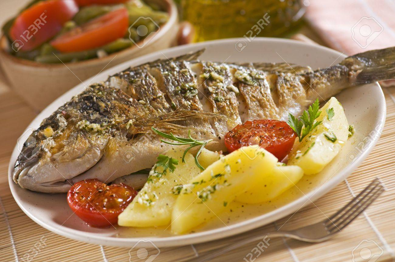 Roasted gilt fish with potatoes and (garlic, parsley) sauce Stock Photo - 5210544