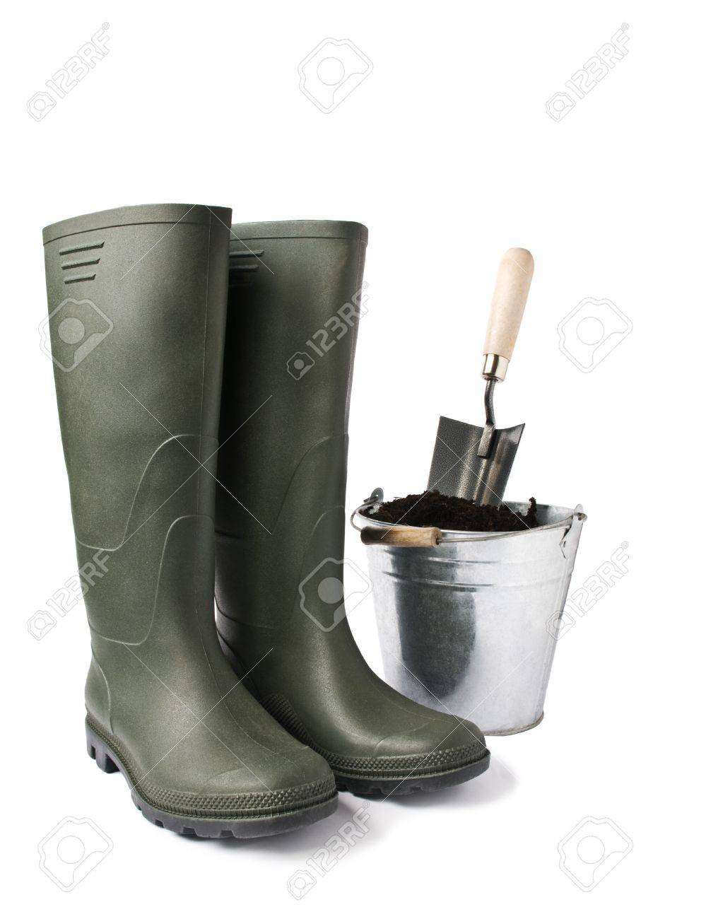 garden boots and bucket with soil isolated on white stock photo