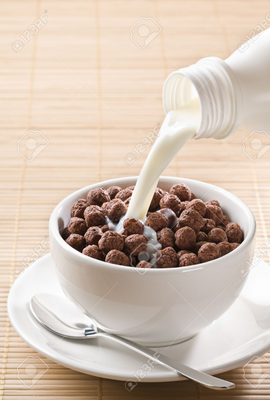 Milk Pouring On Chocolate Cereal Balls Close Up Stock Photo ...