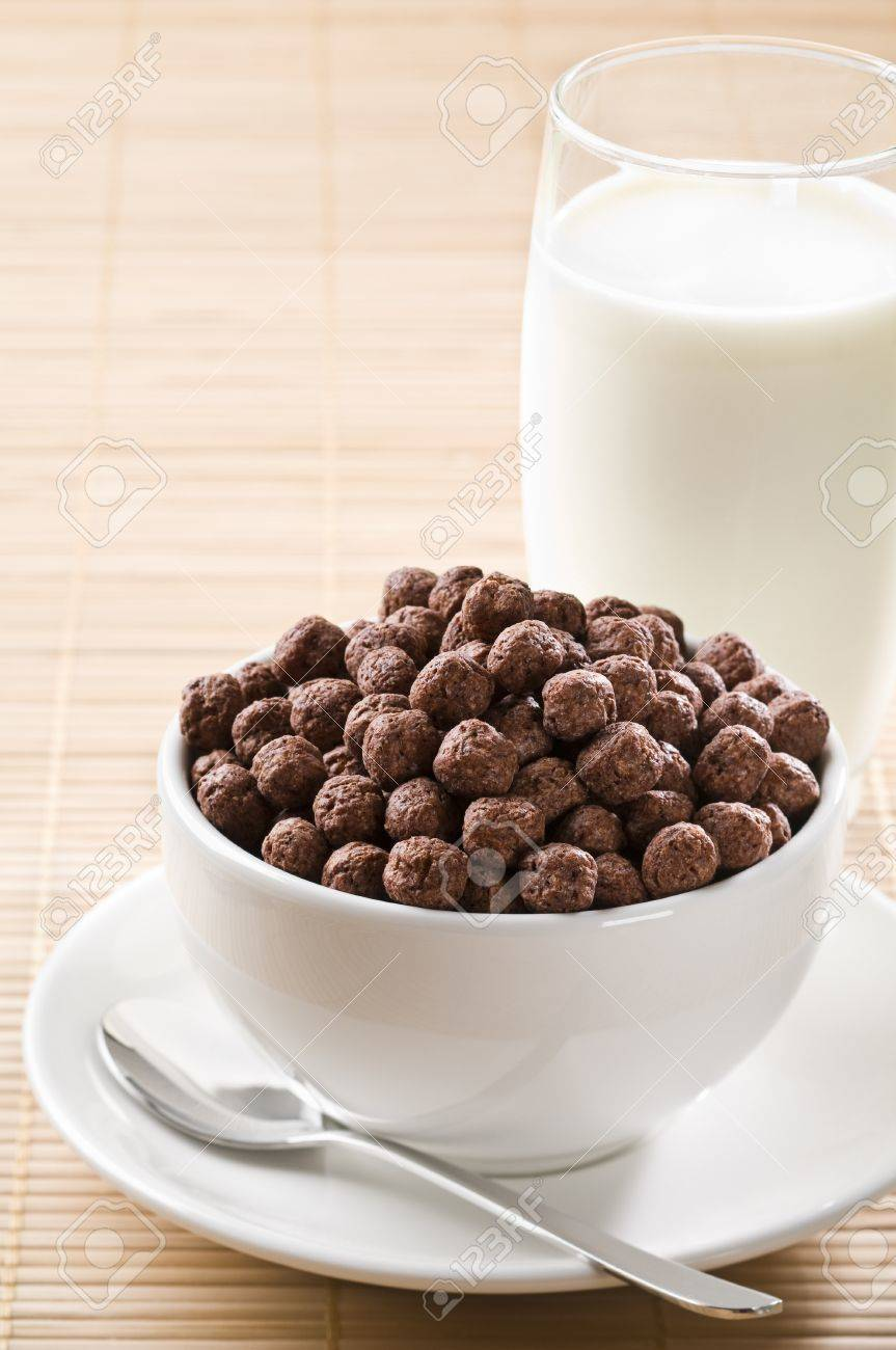 Milk With Chocolate Cereal Balls Close Up Stock Photo, Picture And ...