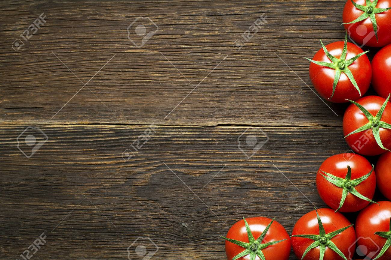 Fresh cherry tomatoes on rustic wooden background - 34037458
