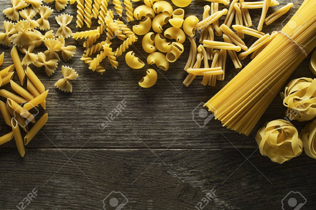Pasta collection on rustic wooden background - 38577468