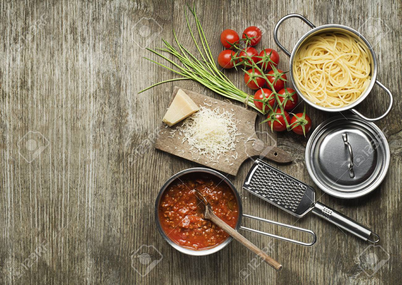 Pasta with bolognese sauce and parmesan cheese on wooden table - 38577476