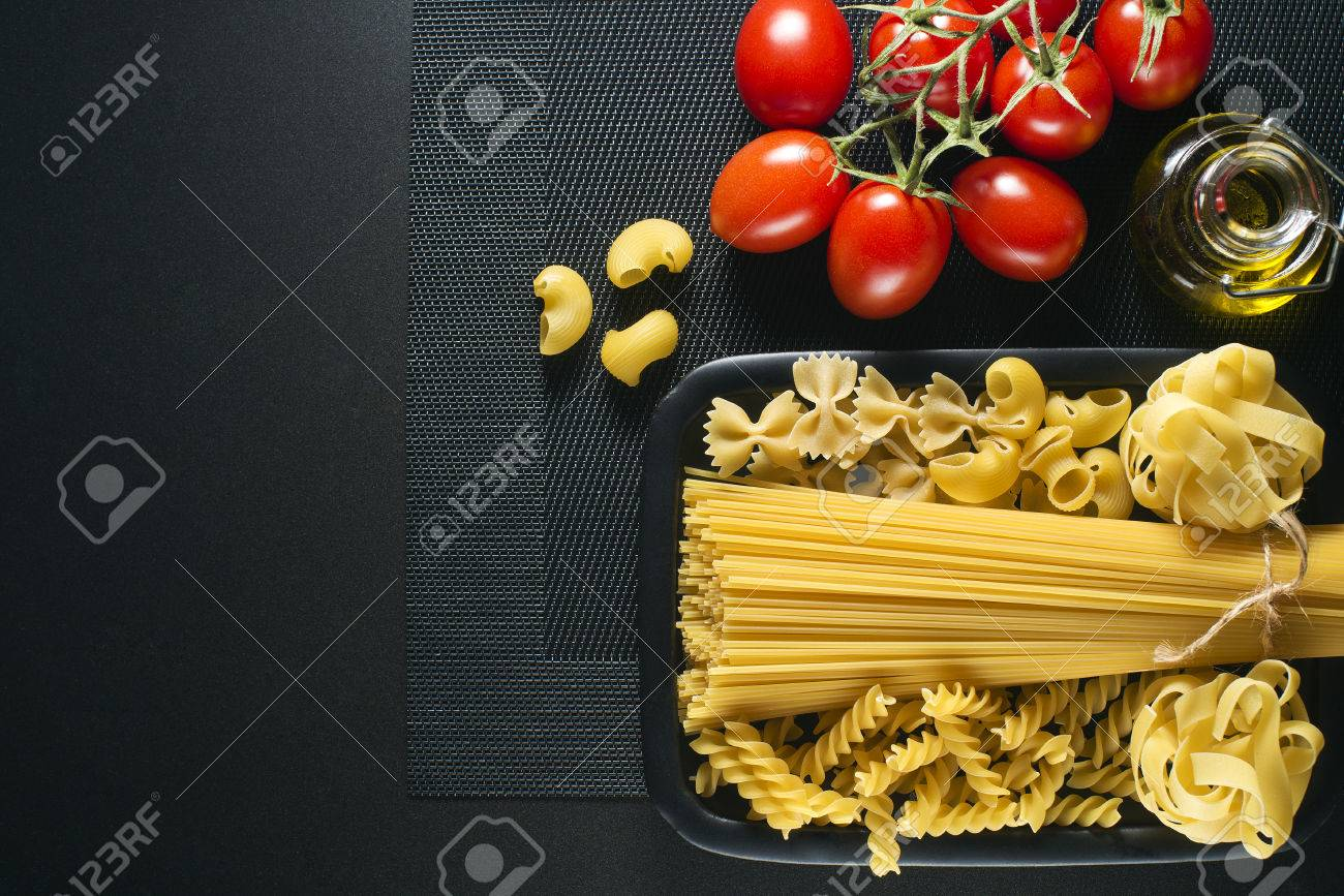 Raw mixed pasta on black background overhead shoot - 39546173