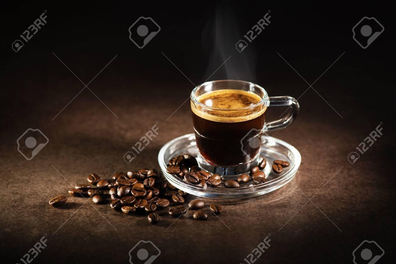 Cup of espresso coffee on dark background. - 66011489