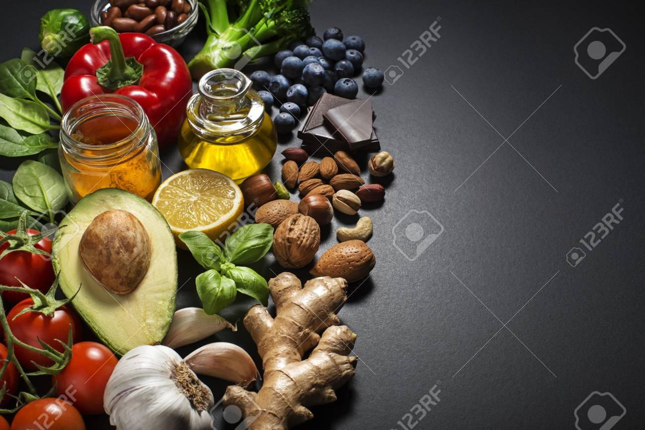 Mixed fresh healthy food on dark background - 73936792