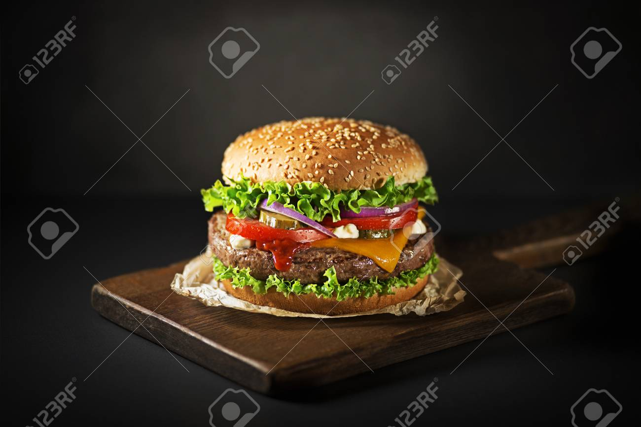 Homemade hamburger or burger with fresh vegetables and cheese - 104660009