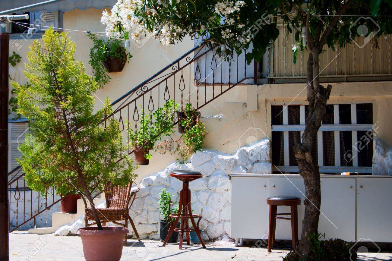 Traditional Greek House traditional greek house. white wall, stairs, plants in tubs