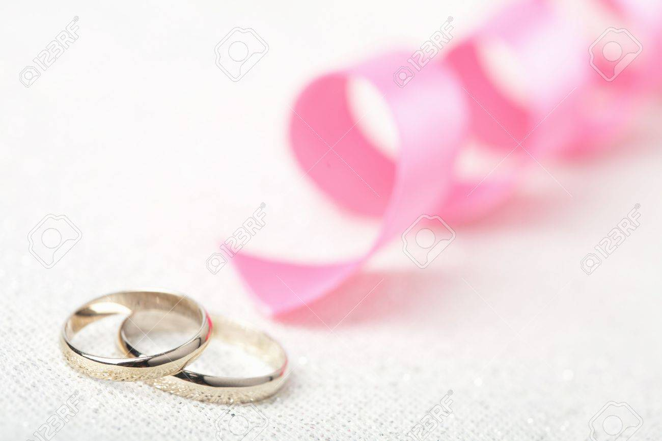 Golden Wedding Rings And Pink Ribbon Stock Photo, Picture And ...
