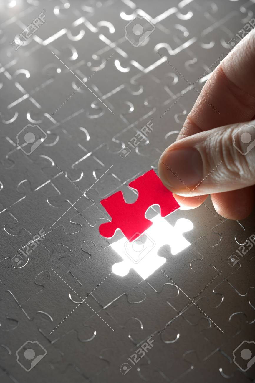 hand holding red puzzle piece Stock Photo - 4768063