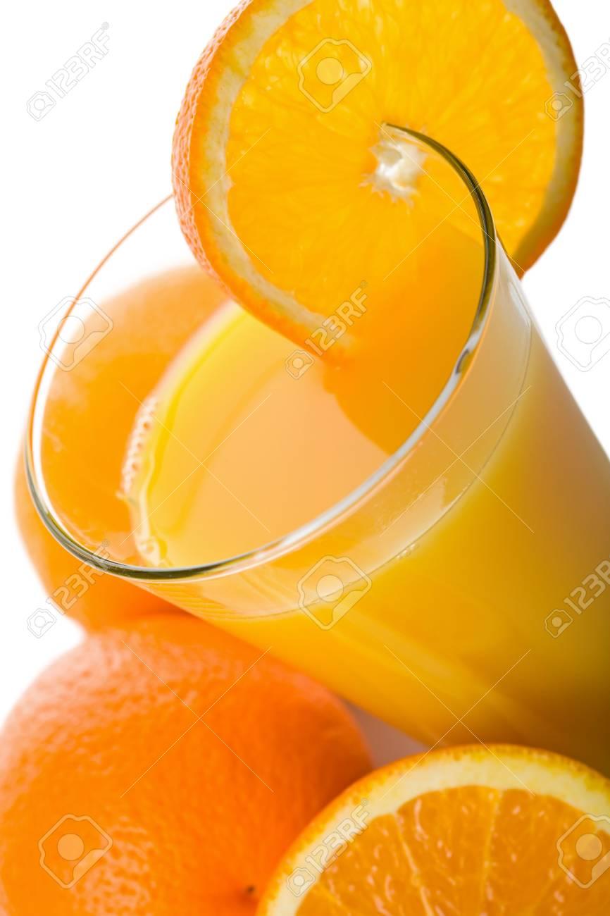 glass of orange juice and oranges isolated Stock Photo - 5053608