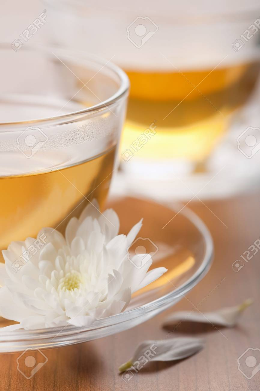 cup of green tea and white flower Stock Photo - 5267662