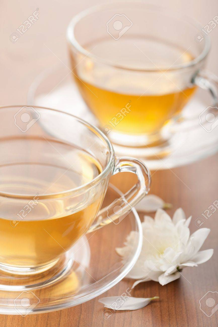 cup of green tea and white flower Stock Photo - 6035641