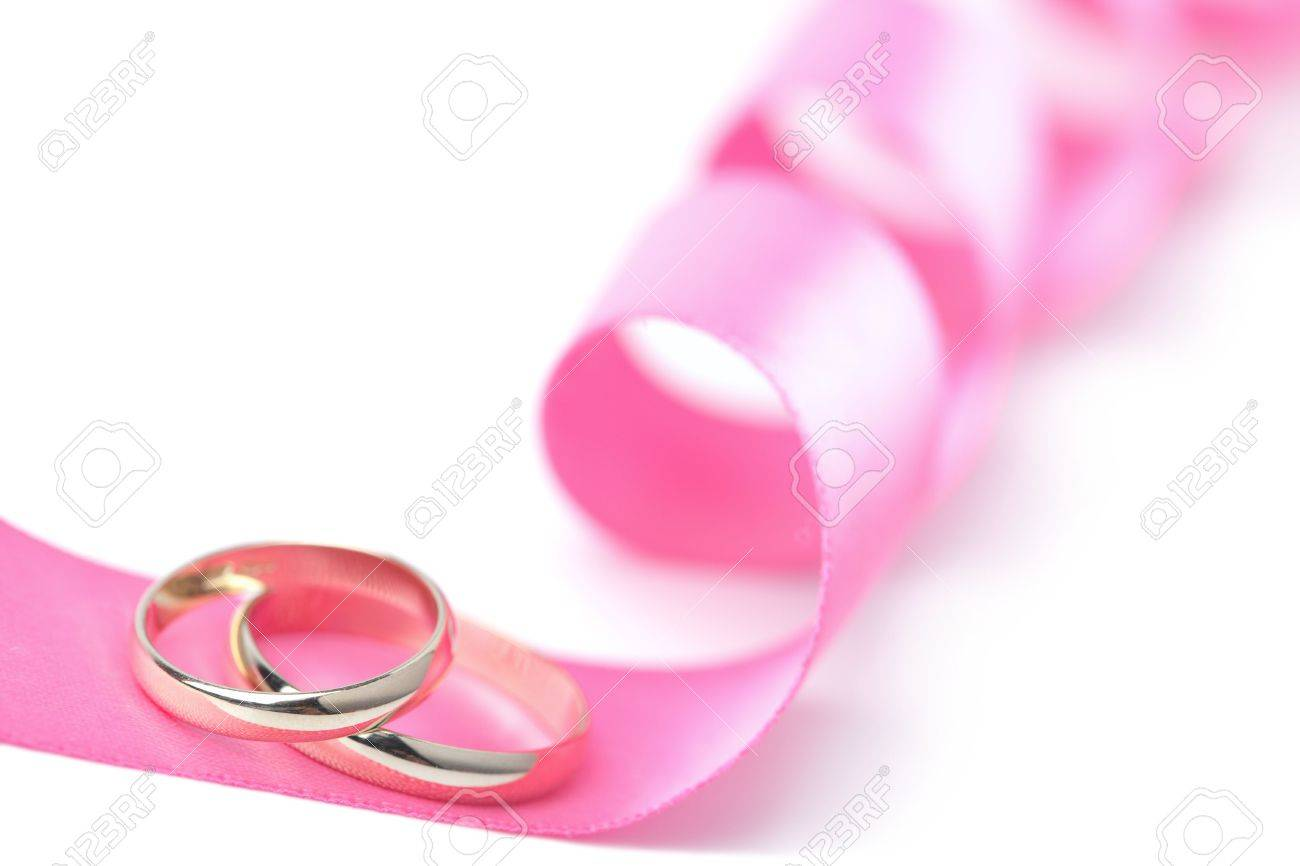 Gold Wedding Rings Over Pink Ribbon Isolated Stock Photo, Picture ...