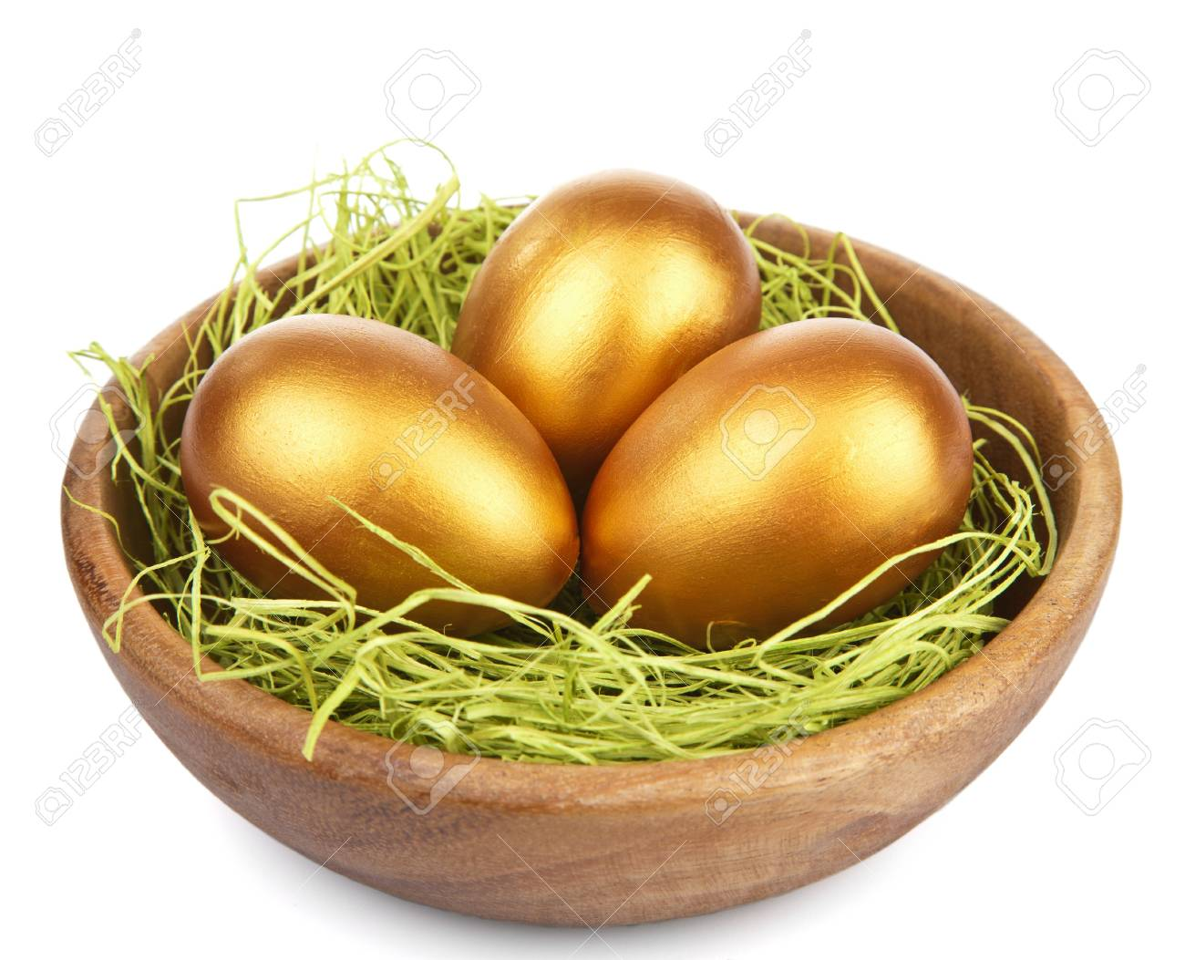 golden easter eggs in bowl isolated Stock Photo - 9151509