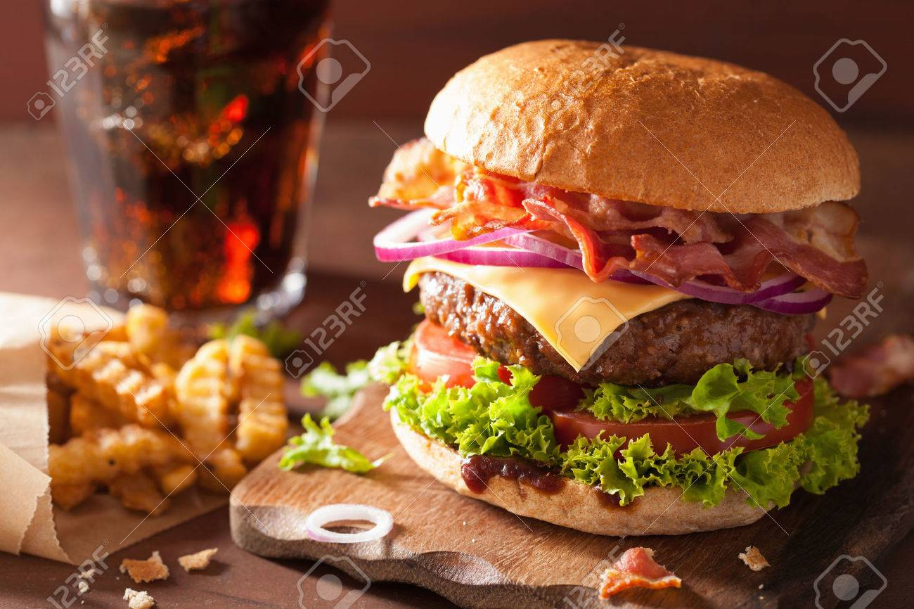 bacon cheese burger with beef patty tomato onion cola - 43494462