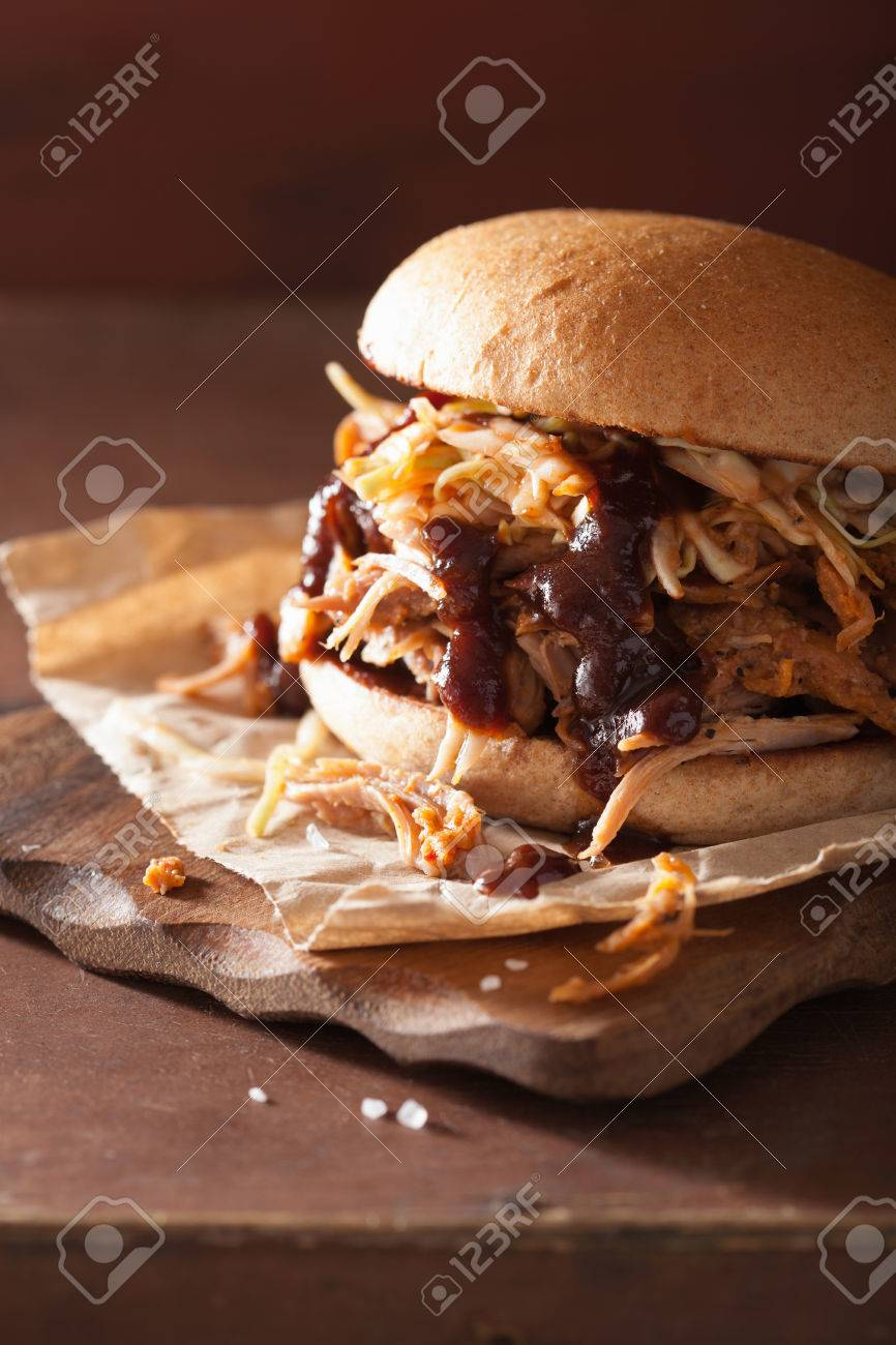 homemade pulled pork burger with coleslaw and bbq sauce - 47499690