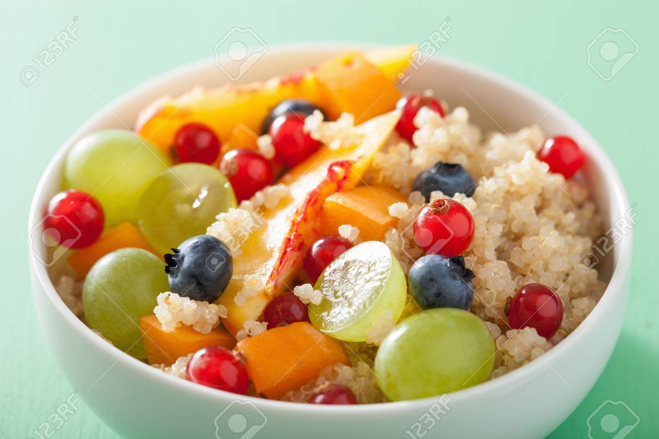 healthy breakfast quinoa with fruits berry nectarine blueberry grape - 57362509