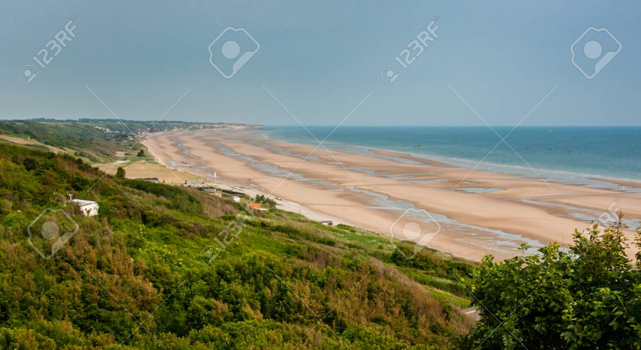 Looking down from the hills at a scenic view of Omaha Beach in