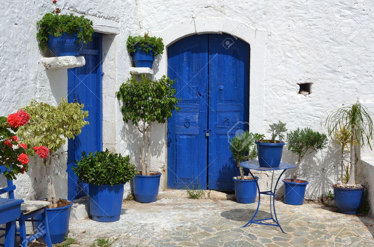 Typical greek courtyard with blue flower pots in Piskopiano on Crete, Greece. Stock Photo - 13373086
