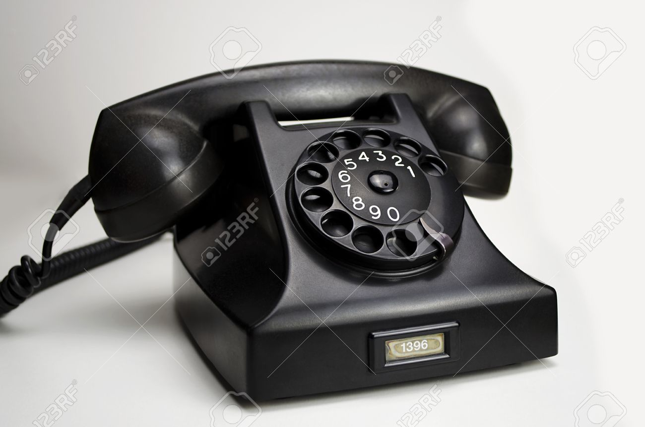 http://previews.123rf.com/images/dutchman74/dutchman741211/dutchman74121100001/16435770-Old-black-Bakelite-telephone-Type-1951-by-PTT-Siemens-with-rotary-dial-isolated-on-white-background--Stock-Photo.jpg