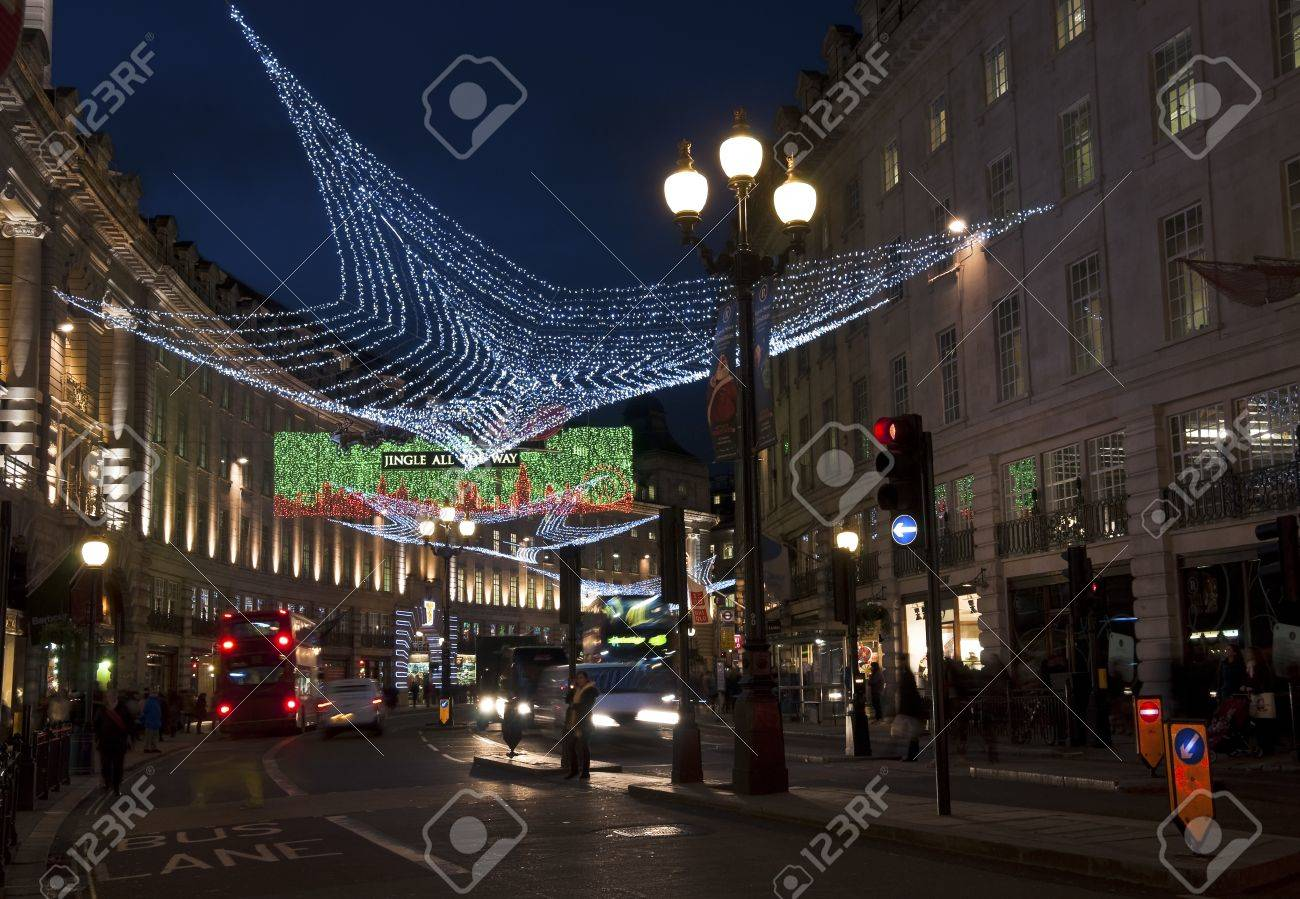 LONDON, UK - DECEMBER 13, 2011: The Christmas decorations are lit in Regent Street on December 13, 2011 in London. Stock Photo - 11542480